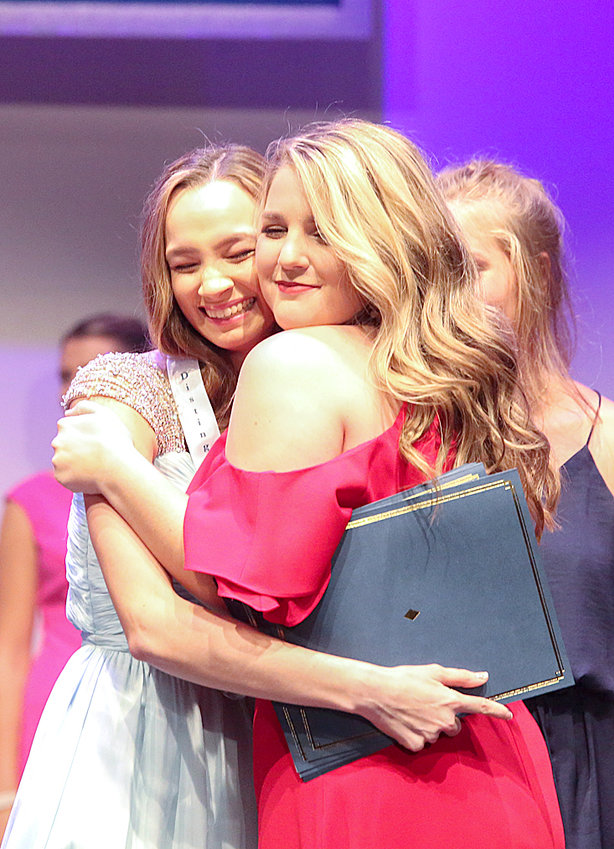 MARY HUMPHREY, DYW of Warren County, left, is congratulated by Madison Dochety, 2019 DYW of Tennessee, as she becomes the 2020 DYW of Tennessee.  Humphrey placed in all 5 categories in the Distinguished Young Women of Tennessee competition on Saturday evening and took home the medalion.