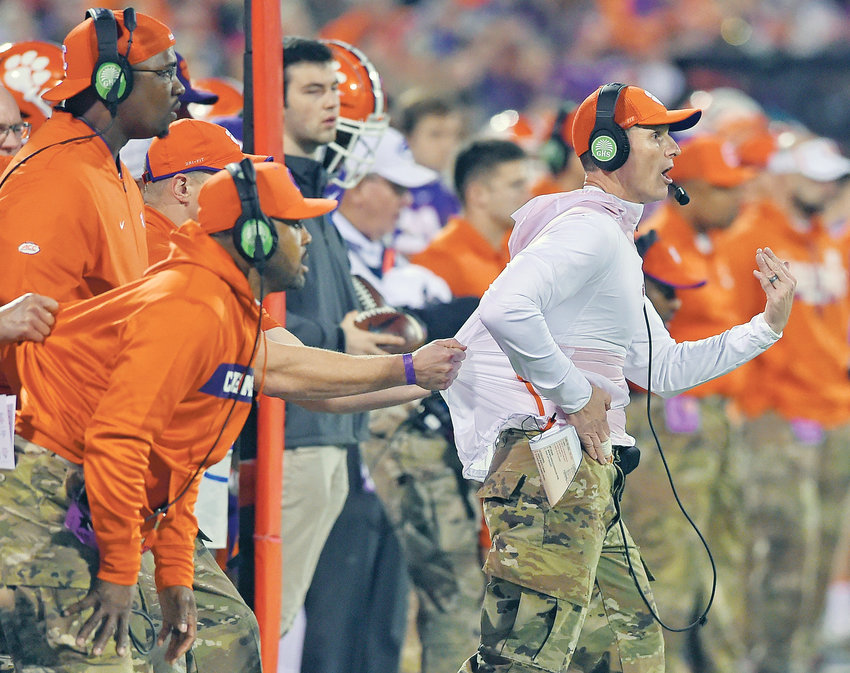 CLEMSON DEFENSIVE COACH Brent Venables is pulled back by an assistant during the first half of an NCAA college football game in Clemson, S.C., in this 2018 photo. Clemson's defense was a big reason why the Tigers won a second national championship in three seasons. Now the unit has massive holes to fill after losing its entire front to the NFL, along with three key linebackers and two members of the secondary.