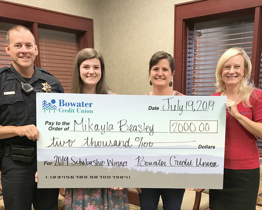 From left are Ryan Beasley, Mikayla's father; Mikayla Beasley, 2019 Scholarship recipient; Cari Beasley, Mikayla's mother;and Kim Gunter, vice president of Marketing/Human Resources Bowater Credit Union.