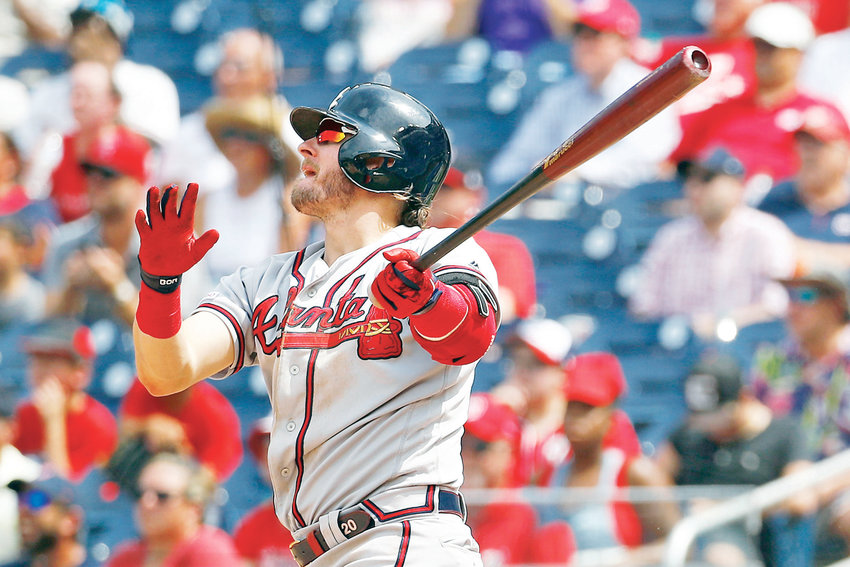 ATLANTA BRAVES third baseman Josh Donaldson watches his solo home run in the 10th inning against the Washington Nationals Wednesday, in Washington.