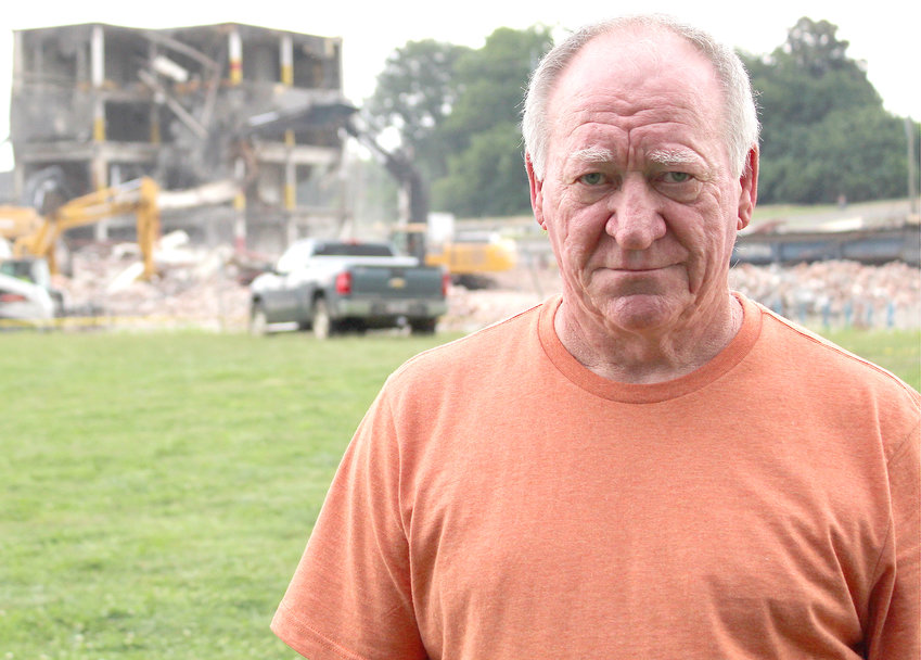 RETIRED WHIRLPOOL employee Allen Vines stands in front of former Whirlpool Plant 2, which once housed Hardwick Stove Company, as the structure was being demolished. The old downtown structure is now completely demolished, leaving only  piles of debris. Vines retired from Whirlpool after working at Plant 1 for more than 40 years.