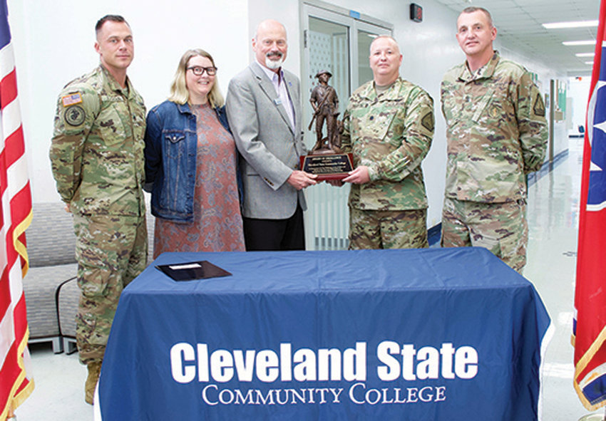 THE TENNESSEE NATIONAL Guard recently held a presentation at Cleveland State Community College honoring the school for its commitment to students serving in the Tennessee National Guard. A formal Letter of Intent was signed by Adjunct General, Major General Jeffrey Holmes and presented to CSCC President Bill Seymour. The letter memorializes CSCC's intent to provide qualified instructors, administrators and support staff to conduct a professional program and to provide appropriate student services to service member applicants. From left are SSG Joseph Baydoun, STRONG Act Outreach NCO; Tishauna Hoffman, Veterans Services coordinator; Dr. Bill Seymour, CSCC president; Lt. Col. John Rigdon, commander of Recruiting and Retention Battalion of Tennessee Army National Guard; and Command SGM Michael Owens.