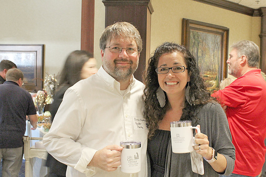 Brian Workman, Bender Realty, and Carrie Workman, Carrie Workman Photography, enjoyed talking at the July Chamber Membership Coffee event.