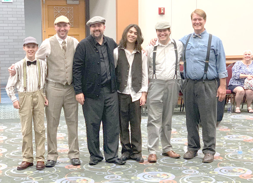 FATHERS AND SONS with the Sound of Tennessee enjoyed competing this summer at the International Barbershop Harmony International Competition. The chorus was awarded 17th in the world. From left are Isaac Simpson, Jake Simpson, Brandon Guyton, Chandler Guyton, Noah Dutton and John Dutton. The Sound of Tennessee is recruiting new members for the a cappella men's chorus. Men from 11 to 80 are invited to have fun singing a cappella barbershop music. The fall kickoff practice is Aug. 20, 7 p.m., at the Church of God Headquarters, evangelism building.