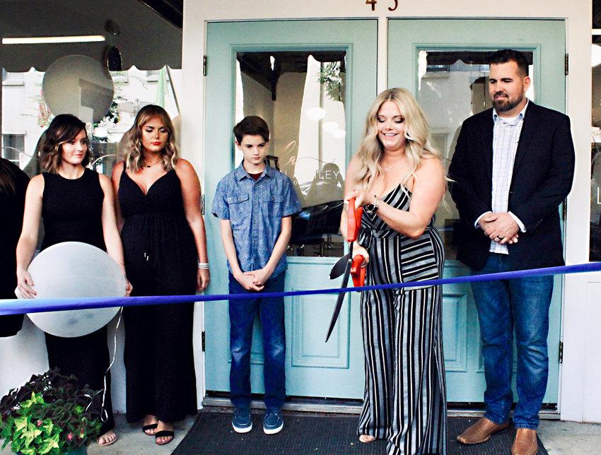 At the ribbon-cutting were, from left, Megan Smith-Burns, Kristen Harter, Ricky Hupfer, owner Lauren Hupfer, and Steven Hupfer.