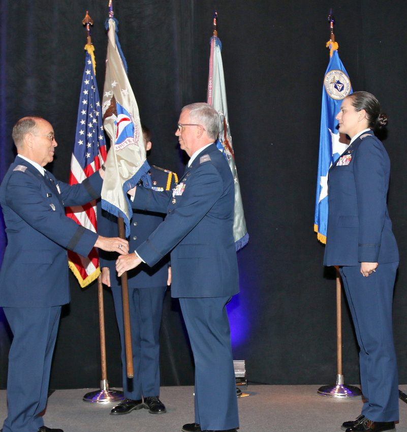 Col. Barry Melton relinquishes the ceremonial flag of Civil Air Patrol's Southeast Region to the U.S. Air Force Auxiliary's commander and CEO, Maj. Gen. Mark Smith, as part of the change-of-command ceremony to install Col. Andrea Van Buren as the region's new leader.