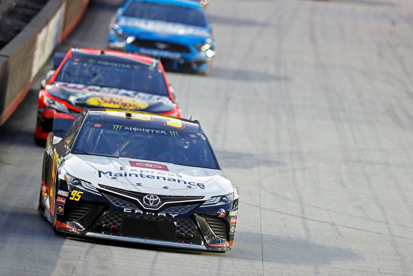 MATT DIBENEDETTO enters turn three at the end of the back straight during Saturday's NASCAR race, in Bristol.