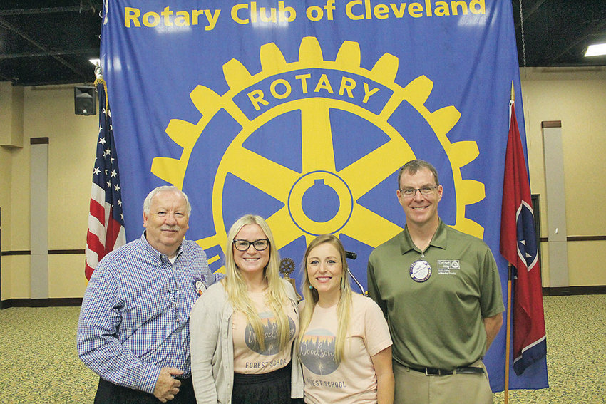 WOODSONG Forest School's founder and Executive Director Bonnie Cretton, third from left, poses for a photo shorty after delivering a presentation about the school, which is located at Johnston Woods in McDonald. Also pictured from left are Rotary Club of Cleveland President Dwight Richardson; Mandi Casteel, Rotary Ambassador Scholar and Cretton's sister; and Rotarian Matt Ryerson