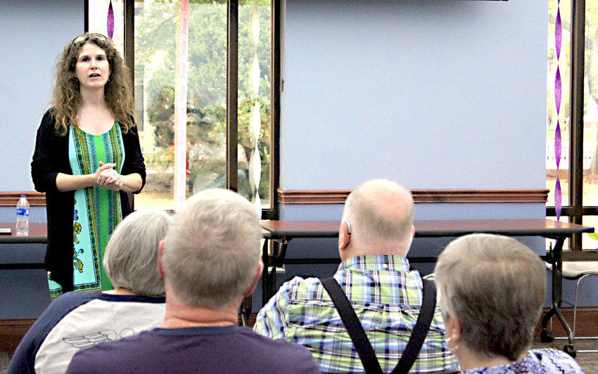 EVA VANHOOK, executive director of Family Promise of Bradley County, speaks to a group gathered for a community meeting the organization hosted at the Cleveland Bradley County Public Library.