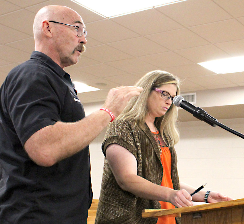 SPCA OF BRADLEY COUNTY Board member Dan Rawls addresses the Bradley County Commission as Amanda Morgan, SPCA's director of operations, organizes her paperwork at the podium, at Monday's meeting.
