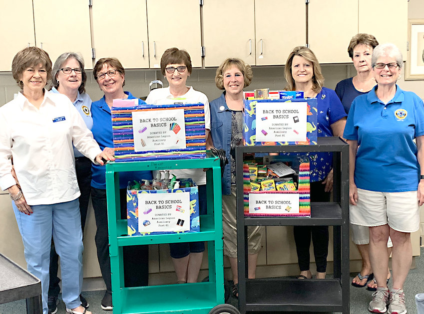 The American Legion Ladies Auxillary recently donated school supplies to Blythe-Bower Elementary School.   From left are  Beverly LeConte, Mary Bauer, Kay Kihnemann, Tammy Hood, Carol Osborne, Janice Higgins, Carol Smith and Janet Allen.