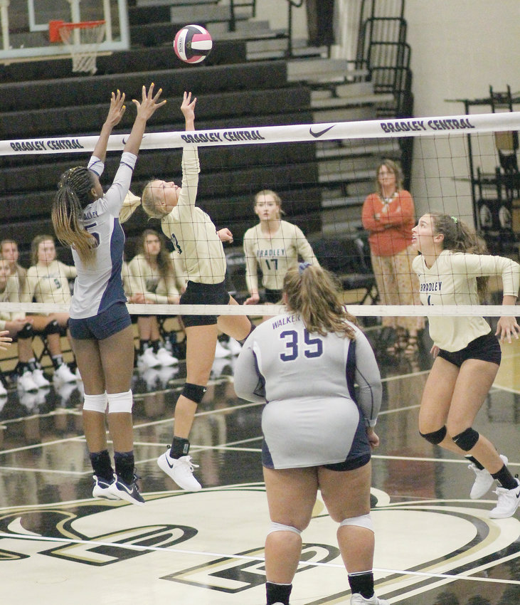 BRADLEY CENTRAL sophomore Ashlan Crittenden, center, tips the ball away from Walker Valley defender Jia Weathersby (25) to teammate Anna Muhonen (4) for the kill, while Lady Mustang Sophie Frederick (35) looks on during Thursday evening's District 5-AAA opener at Jim Smiddy Arena.
