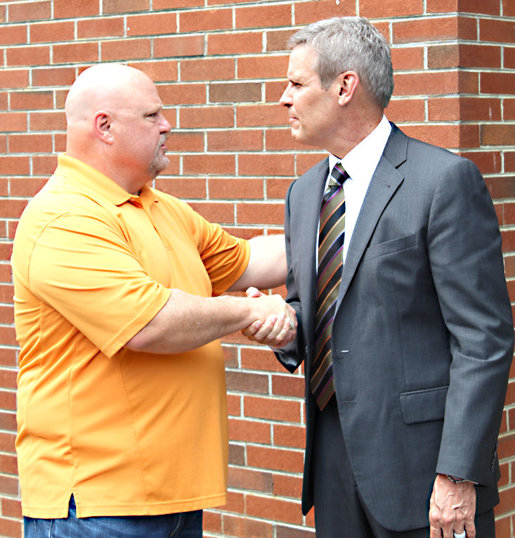 TENNESSEE GOV. BILL LEE, right, shakes hands with Stan Howard, who represents the Second District on the Polk County Board of Education. The school board member welcomed the governor's tour of Benton Elementary School in Polk County.