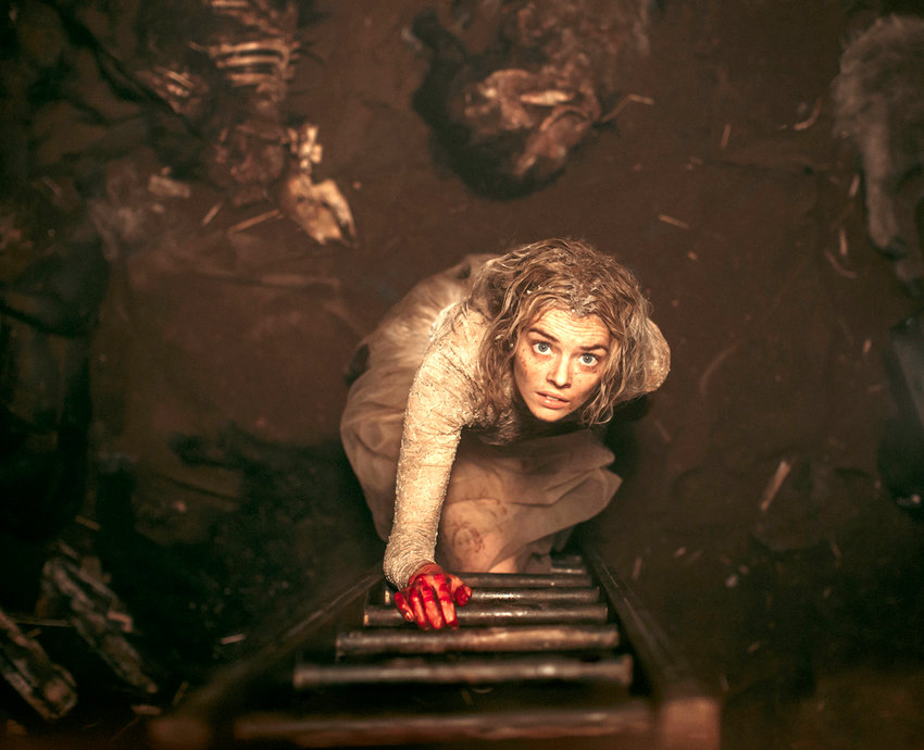 "This image provided by Fox Searchlight Pictures shows Samara Weaving in the horror film ""Ready or Not."" Weaving plays a bride who tries to stay alive until dawn on her wedding day as her in-laws hunt her down and try to kill her. (Eric Zachanowich/Fox Searchlight Pictures via AP)"