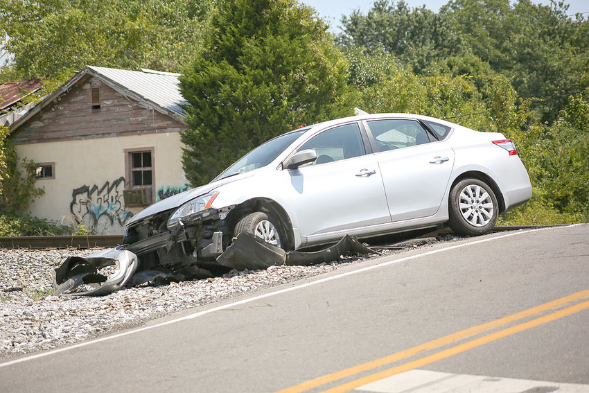 A 2015 NISSAN is shown after crashing on a train track located on 15th Street in Cleveland. According to the Cleveland Police Department, the driver drove off the road and crashed into a section of the track after her vehicle encountered another vehicle that was driving at a high rate of speed from the opposite direction. Although two of the vehicle's four passengers were injured, both refused transport to a hospital.