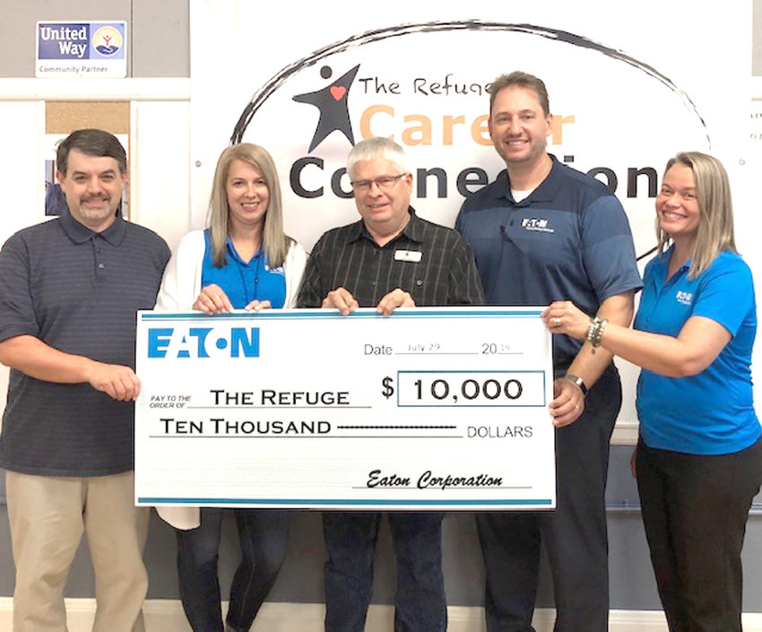 EATON CORPORATION employees recently presented a $10,000 grant to local nonprofit The Refuge. From left are Brian Stewart of The Refuge, Lori Burmeister of Eaton, Dr. Terry Johns of The Refuge, and Quincey Bentley and April Cole, both of Eaton.