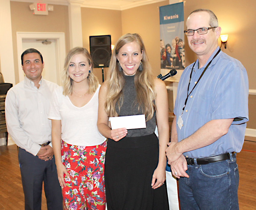 HAILEY JOHNSTON, second from right, and Ellie Topinka, second from left, from the Cleveland nonprofit, Free 2 Fly, were guests of the Cleveland Kiwanis Club this week. Following the program, they talked with Kiwanis Club President Ramon Torres, right, and Program Chairman Jake Duos, left.
