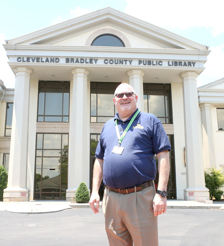 CLEVELAND BRADLEY PUBLIC LIBRARY Director Andrew Hunt stands in front of the downtown library. The library is opening this week by appointment.
