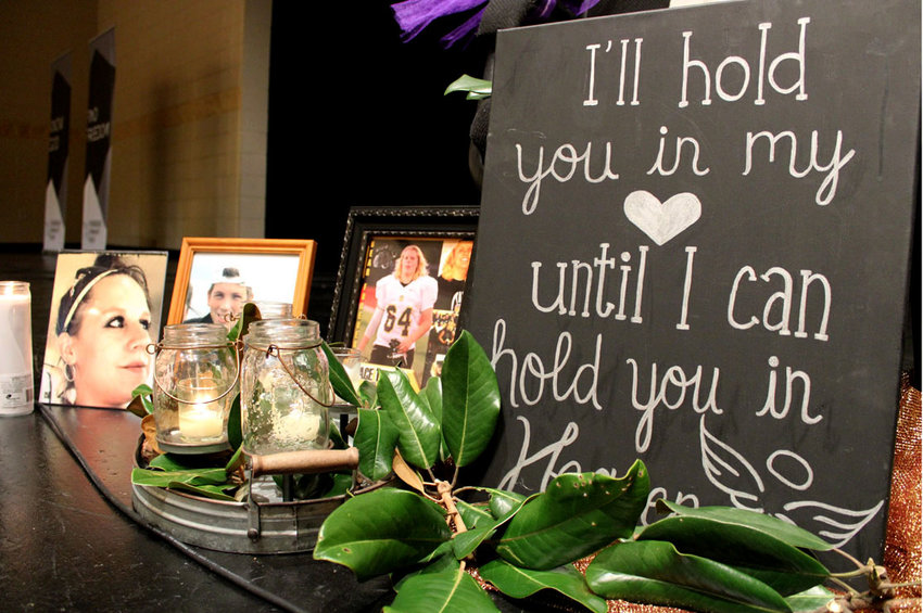A MEMORIAL for young students of Bradley County lost to overdose sits on the stage at Bradley Central High School on Saturday for Overdose Awareness Day.
