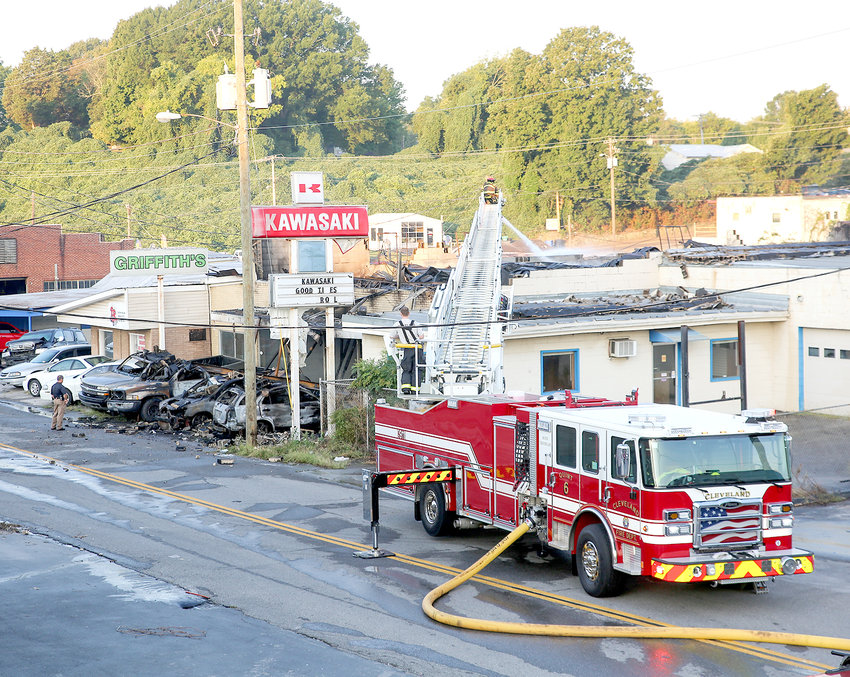FIREFIGHTERS CONTINUE to bring the scene of a fire under control located at the corner of Worth Street S.W. and First Street S.W. on Wednesday morning. The damaged building is a former motorcycle repair shop. Answering the fire alarm early today was the Cleveland Fire Department.