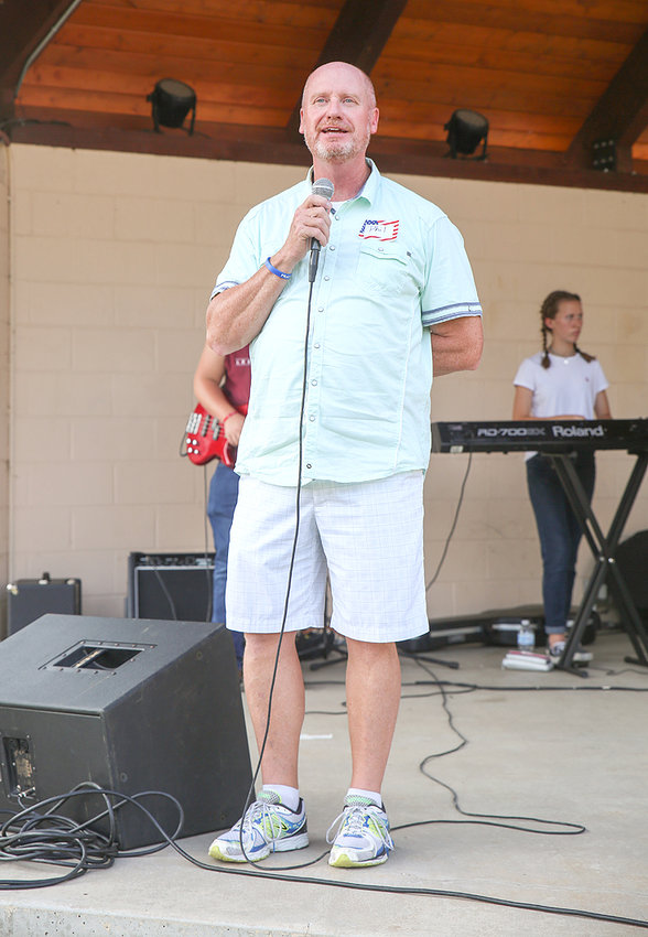 PHIL GRIFFIN welcomes the crowd to the Greenway Park stage for the annual Cry Out America event.