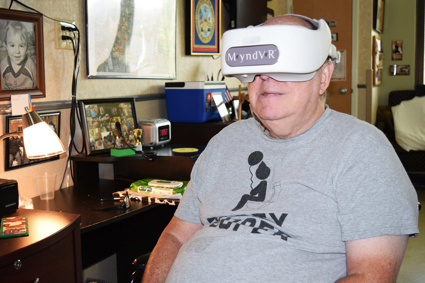 VIETNAM WAR VETERAN Rick Stern, a patient at the Veterans Home in Murfreesboro, is shown using one of the MyndVR headsets with the new virtual reality program being launched by Tennessee State Veterans Homes. The service will begin in Murfreesboro, then be included at the Humboldt, Knoxville and Clarksville facilities. This service will also be available at the Bradley County/state veterans home, once construction has been concluded.