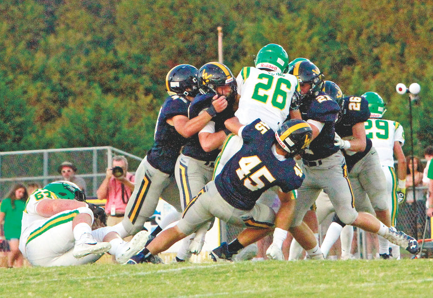 THE WALKER VALLEY defense swarms a Rhea County runner during last week's matchup, in Evensville. After a week off, the Mustangs are back to work Friday with a road trip to Sparta to meet the White County Warriors.
