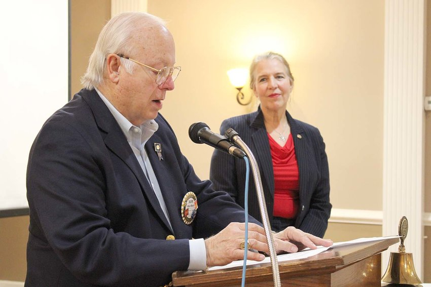 ROTARIAN Alvin Word lists 10th Judicial District Criminal Court Judge Sandra Donaghy's education and professional work during the Sunrise Rotary's presentation of the Paul Harris Fellow award.