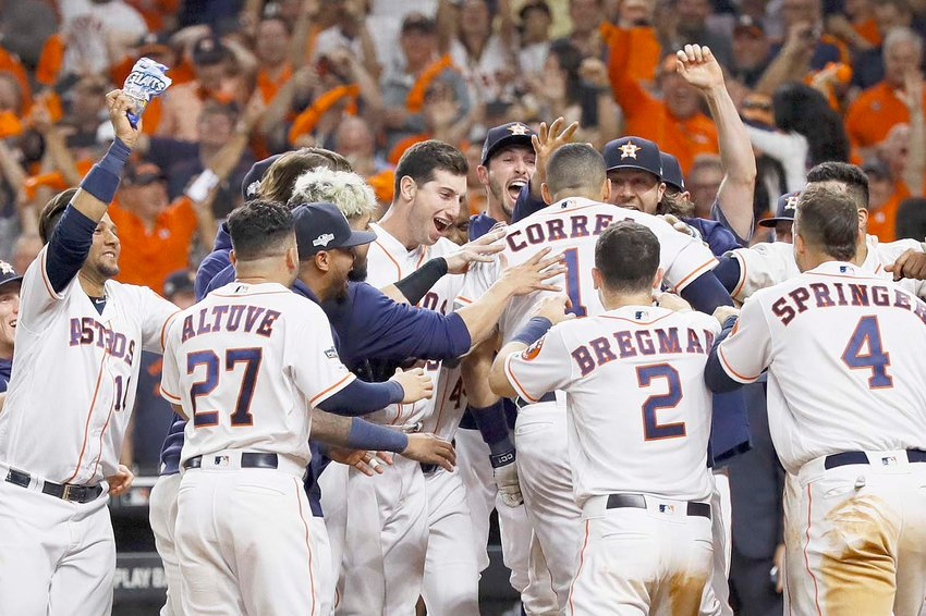 HOUSTON ASTROS' Carlos Correa celebrates with teammates after his walk-off home run against the New York Yankees during the 11th inning in Game 2 of baseball's American League Championship Series Sunday night, in Houston.