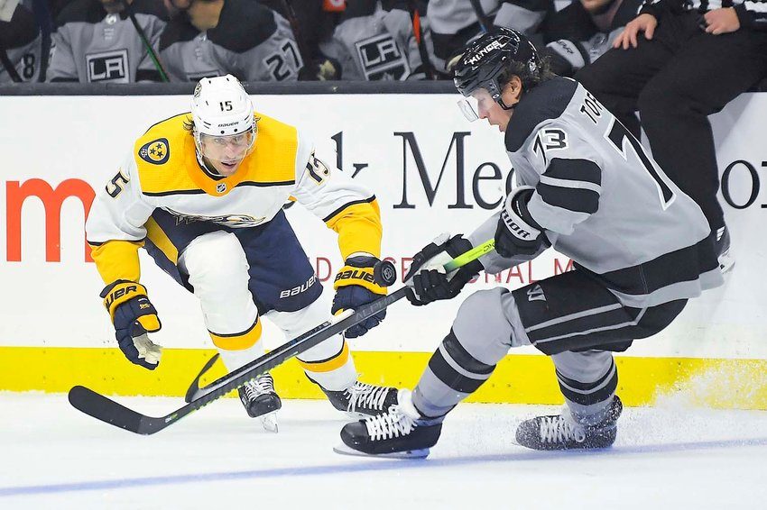 LOS ANGELES Kings center Tyler Toffoli, right, moves the puck as Nashville Predators center Craig Smith puts pressure on him during the second period of Saturday evening's NHL game in Los Angeles.