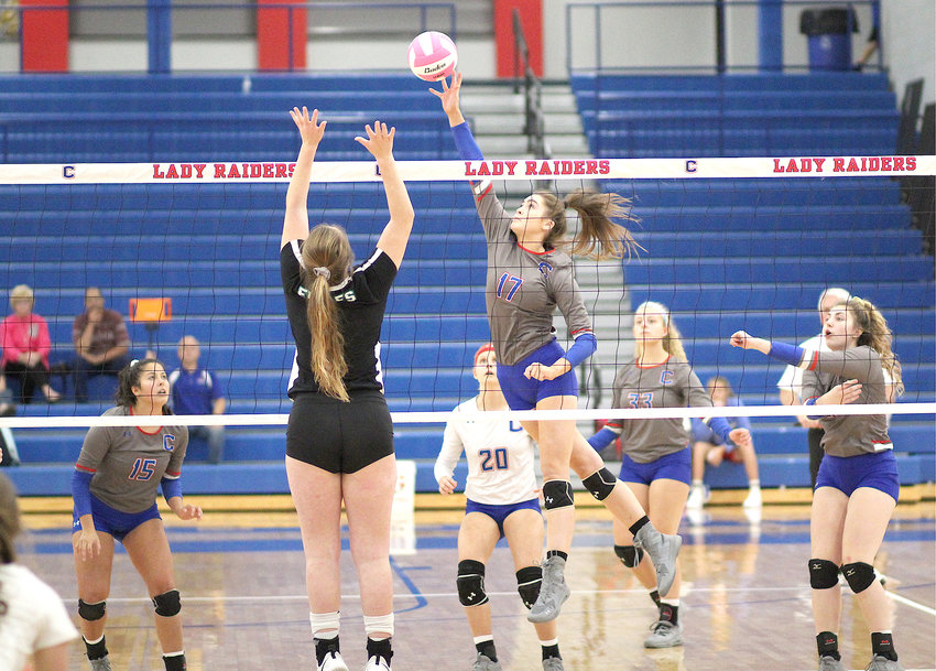 CLEVELAND HITTER Lilly Oliver (17) battles a Rhea County blocker during the opening game of the Region 3-5A volleyball tournament Monday inside Raider Arena.
