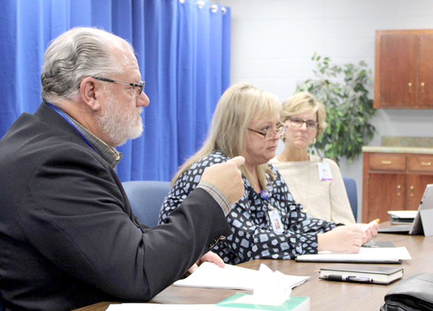 DIRECTOR OF OPERATIONS Hal Taylor offers options for the broken chiller at Cleveland High School during a Site Committee meeting on Wednesday.