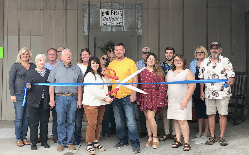 At the grand opening were, from left, Sharon Marr of Mainstreet Cleveland; Von Conley, David Conley Jr, Tommy Rouser, David Conley, Alisha Cox, owner Melissa Armstrong, Karen Moser, James Moser, owner Shane Armstrong, Owen Martin, Sami Dotson, Andy Tate, Shea Tate, Dee Rummel, and Greg Rummel.