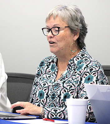 DAWN Robinson, Cleveland Board of Education chair, discusses agenda items pertaining to the Consent Agenda during Monday's school board meeting.