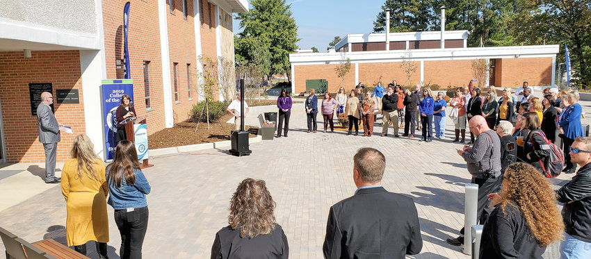 CLEVELAND STATE Community College President Dr. Bill Seymour addressesstaff members and attendees outside the D.F. Adkisson Administration Building, where a ribbon-cutting ceremony was also held for a new plaza outside the administration building's entrance.