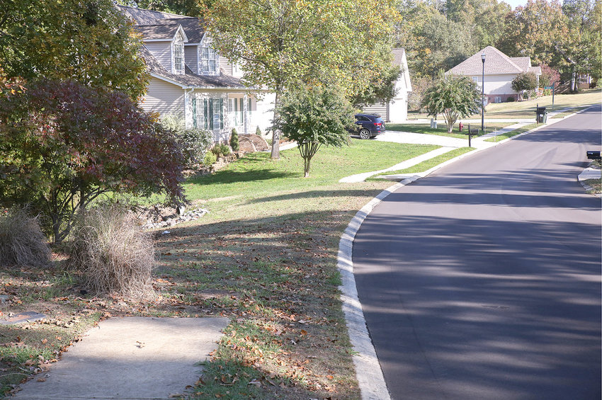 THESE SIDEWALKS in Benwood subdivision are examples of some of the issues listed in the county's Self-Evaluation & Transition Plan. The sidewalk pictured represents some of the sections of sidewalk that are missing because of undeveloped lots.