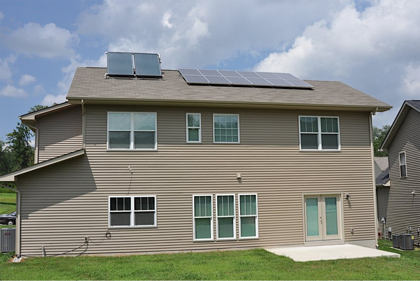 SOLAR PANELS adorn this Tennessee Valley home, where the owner participates in the Tennessee Valley Authority's solar energy program. Investing in solar panels is expensive, taking up to 10 years to recoup.