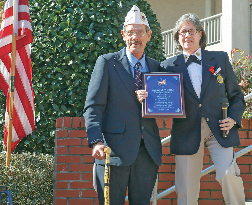 DANIEL KOOB, left, was the Raymond H. Miller Veteran of the Year Award recipient at this year's Veterans Day program. Presenting him the award is Mary Baier.