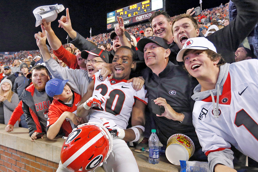 GEORGIA DB J.R. Reed (20) celebrates with fans after the team defeated Auburn 21-14 Saturday in a key SEC game, in Auburn, Ala.
