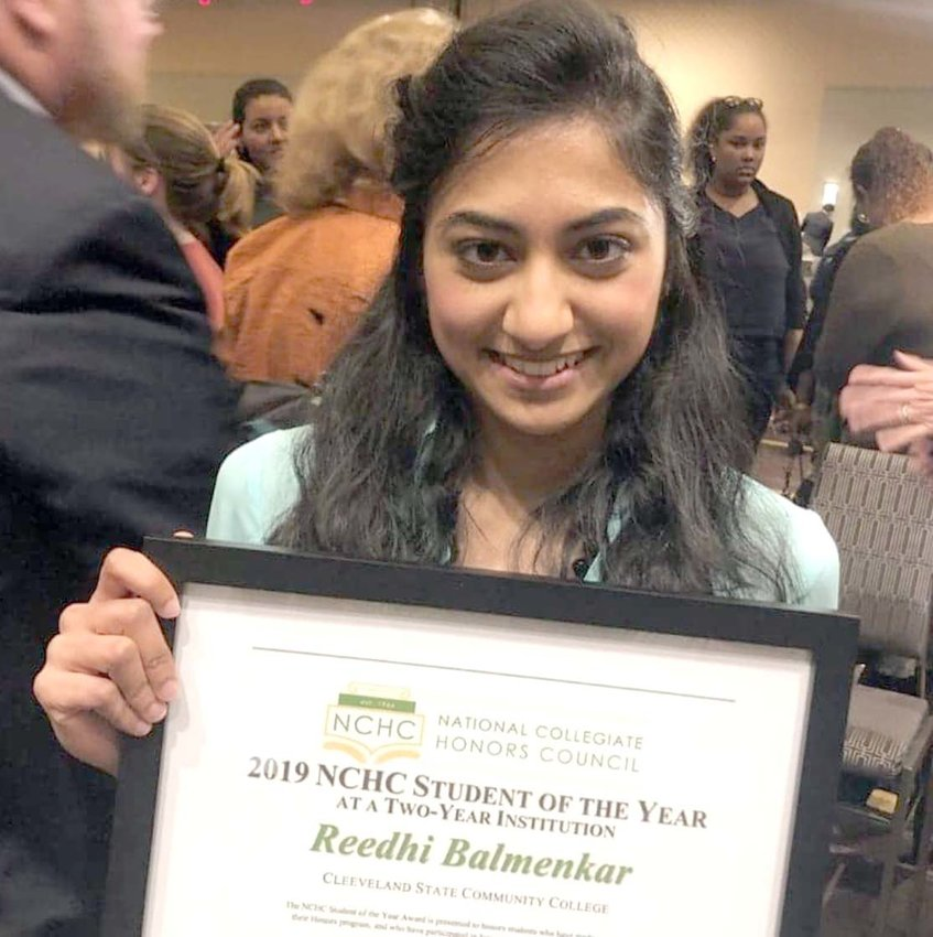 Reedhi Bamnelkar, Cleveland State Community College Honors College student, holds her National Collegiate Honors Council Student of the Year award shortly after being awarded it at the NCHC conference in New Orleans, Louisiana.