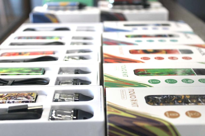 A ROW of Novo e-cigarettes is lined up in a case at a local vape shop in Cleveland.