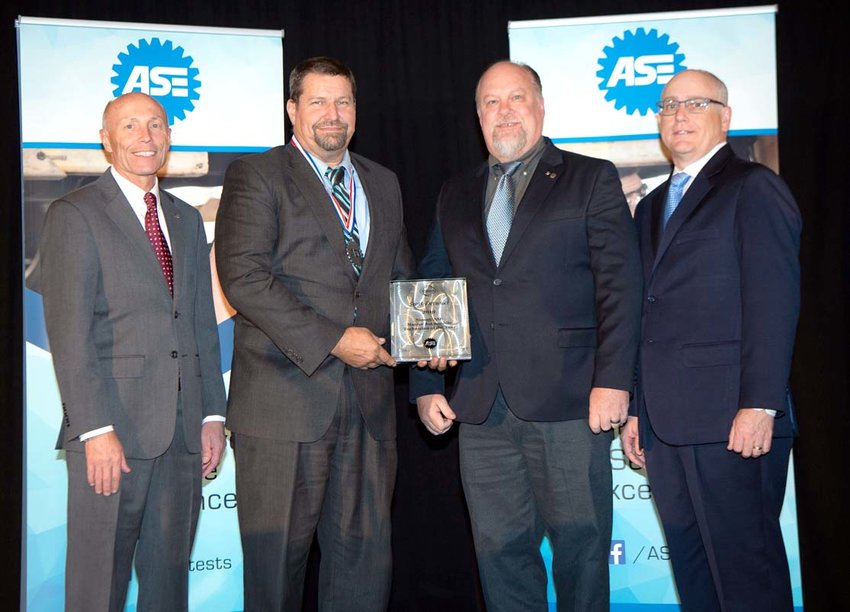 TIMOTHY ZILKE, from left, ASE president and CEO, presented Scott Detwiler of Charleston with the Nissan/ASE Master Automobile Technician of the Year, at the fall board of governors meeting in Phoenix, Ariz. Also participating in the presentation were Paul Mathias, Paul Mathias, Western area technical training manager for Nissan; Tom Trisdale, ASE Board chair.