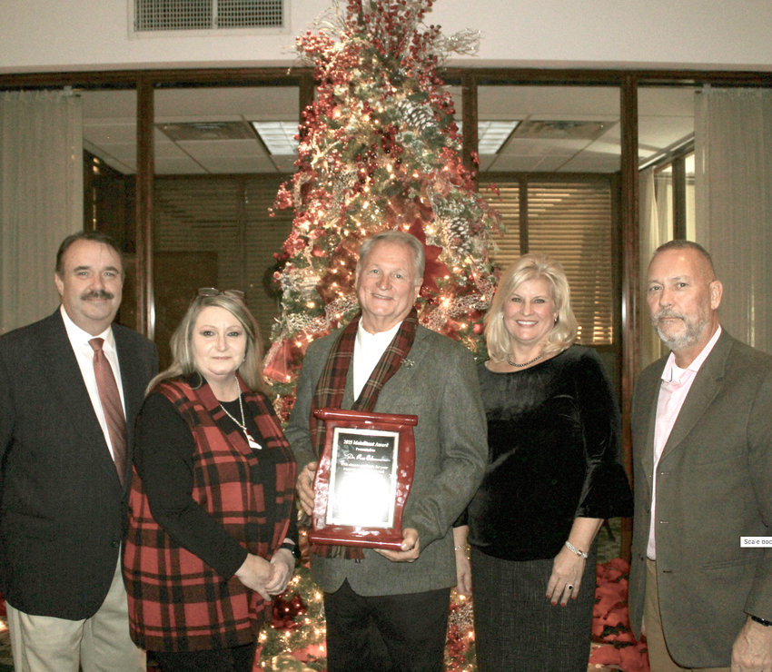 DR. RON COLEMAN, third from left, was named recipient Wednesday night  of the annual MainStreet Cleveland Award in recognition for revitalizing the Old Woolen Mill in downtown Cleveland. From left are 2017 recipients Barry and Kim Currin; Coleman; MainStreet Cleveland Executive Director Sharon Marr; and MainStreet Cleveland Board Chairman Jim Metzger.