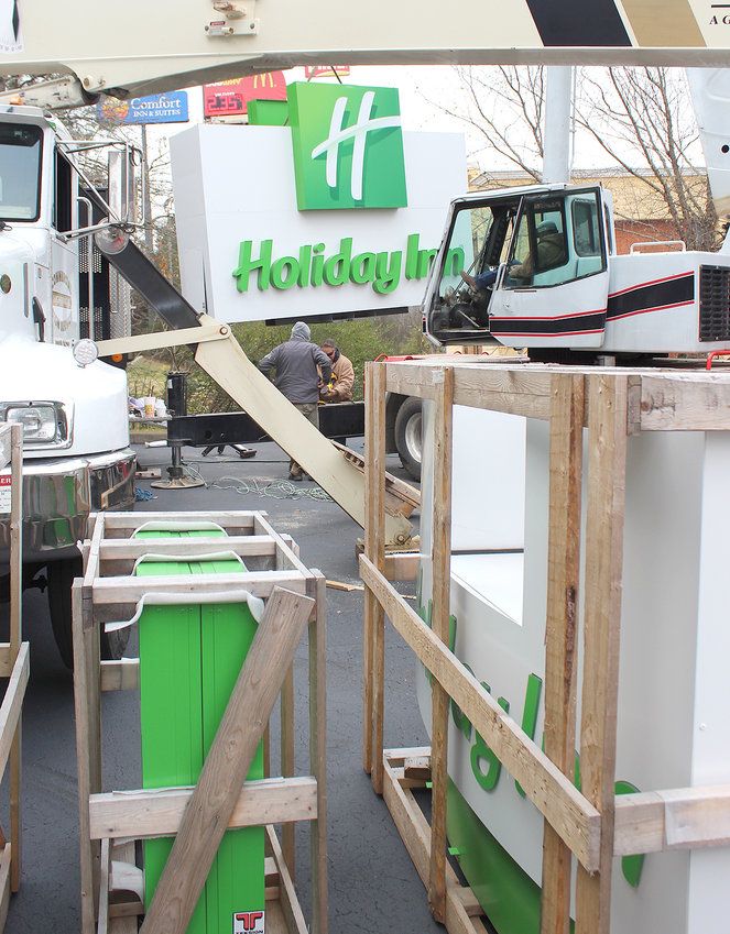 WORKERS WERE BUSY Tuesday with the large Holiday Inn sign in the background, which was being placed high above the newly branded hotel on Interstate Drive in West Cleveland, off Candies Lane. This sign will overlook the entrance ramp onto Interstate 75 South, coming off Highway 60 (Georgetown Road and 25th Street).