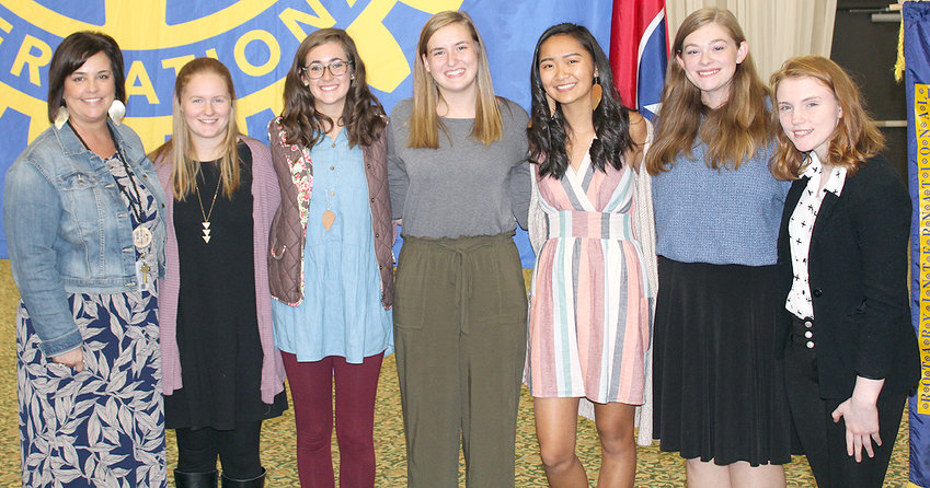 WALKER VALLEY HIGH SCHOOL students Rachel Marler, Chandler Brandt, Anna Garner, Annagrace Asbury, Jenna Kraft and Ivy Miller pose with their teacher, Leann Klepzig, left, after describing their experiences operating a food pantry at their high school.