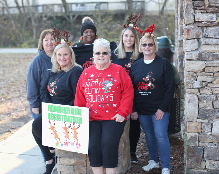 REINDEER RUN VIPs prepare for the event to begin Saturday morning. From left are Patricia Lamon, Donna Goins, Lisa Smith, Cheryl Disharoon, Kelsea Goins and Kathy Douglas.