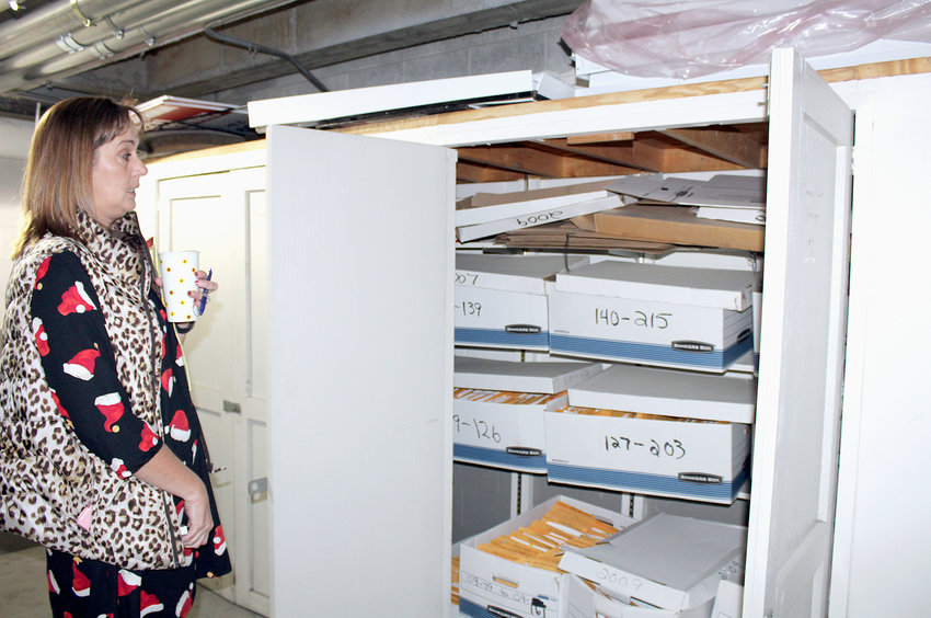 BRADLEY COUNTY Clerk and Master Holly Thompson stands beside one of the storage cabinets available for her office's use, in the garage under the Bradley County Courthouse.