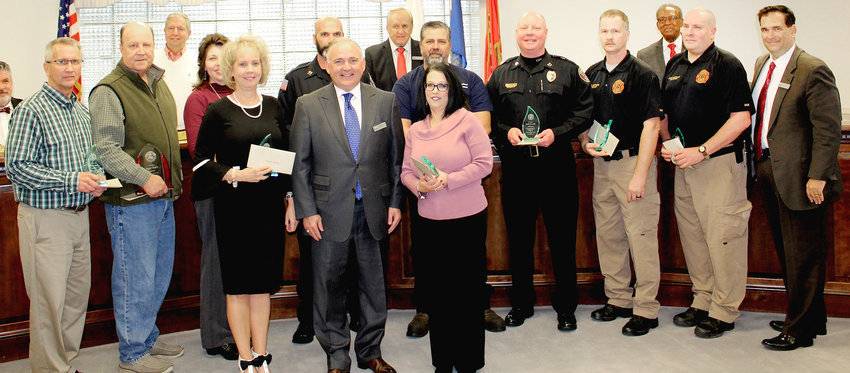 CLEVELAND city employees hold their service awards after being recognized for their many years of service to the city. Pictured are Melinda Caldwell, 35 years; Tommy Myers, 35 years; Roger Turpin, 30 years; Amy Newman, 25 years; Robert Harbison, 25 years; Cathy White, 20 years; Robert Chastain, 20 years; Thomas S. Smith, 20 years; Henley Ledford, 20 years; and Jeremy Greenleaf, 20 years. Not pictured are Josiah Shelton, 20 years; Roy Stinnett, 20 years; Mark Elrod, 20 years; April Ratcliff, 20 years; Gordon Ford, 20 years; and Jerry Vanderoef, 20 years.