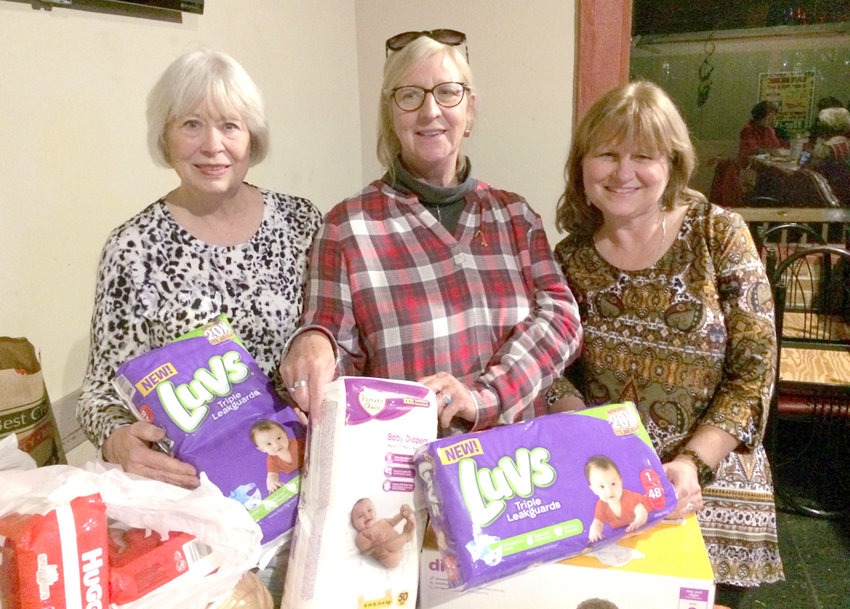 Members shown with the donation for New Hope Pregnancy Center were, from left, Cheryl Gilbert, Mayfield; Linda Gibson, Mayfield; and Angela Gardner, Mayfield.
