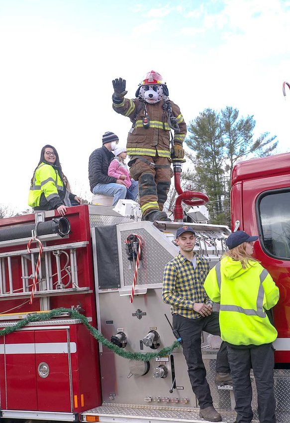 SPARKY THE DALMATION waves from atop the fire engine in the Benton Parade.